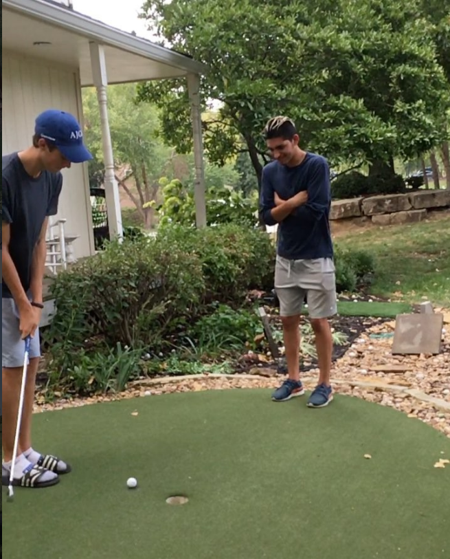 Impressive golf trick shot involves trusting friend