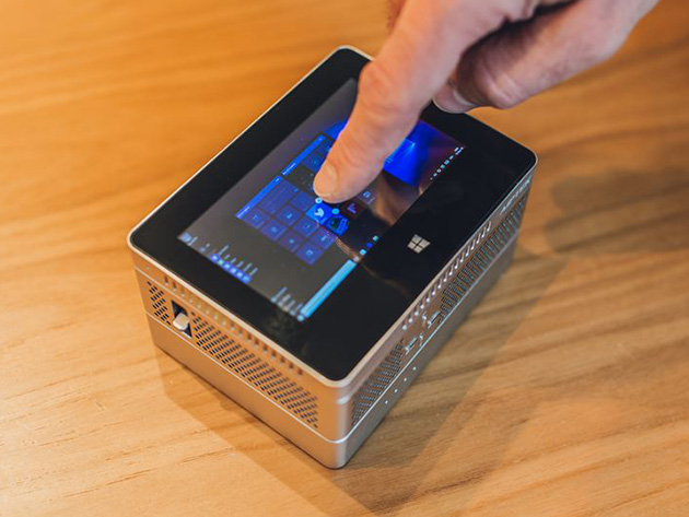 The iBeamBLOCK is a projector, tablet, and external battery rolled into one