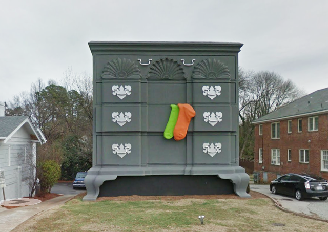 """Built in the 1920s as High Point, North Carolina's """"Bureau of Information,"""" this 36-foot-tall The Goddard-Townsend style dresser/building represents the ..."""