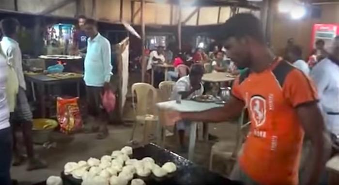 Watch: Bread maker flings dough across restaurant with astonishing accuracy