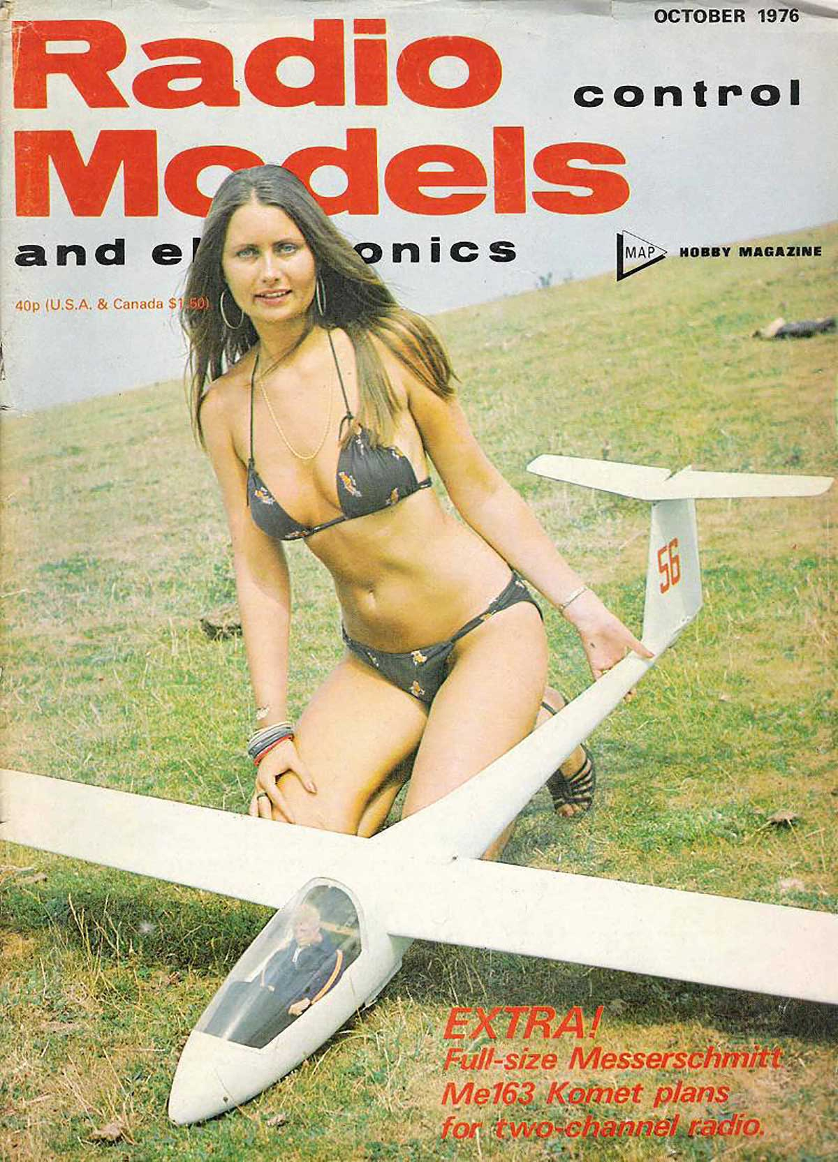 Is this a tiny person in a glider being held by a woman in a bikini, or a giant woman in a bikini holding a...