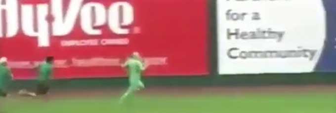 Man in green suit on baseball field recreates iguana escape scene from Planet Earth II
