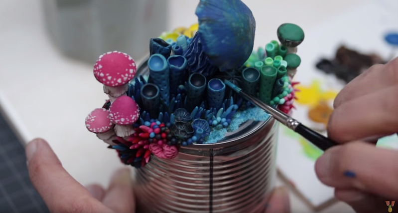 Artist adorns trash with vibrant sculptures resembling coral and mushrooms