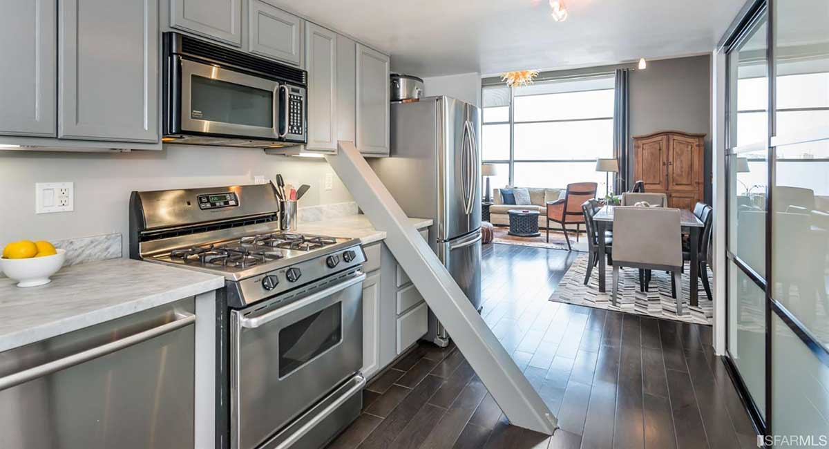 $1 million San Francisco loft has diagonal support beam that cuts through the middle of the kitchen