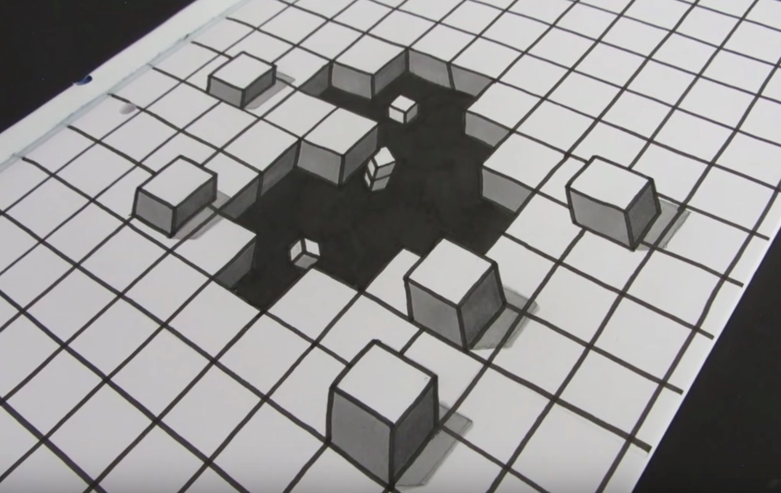simple way to draw a 3d optical illusion of cubes falling through the paper boing boing. Black Bedroom Furniture Sets. Home Design Ideas