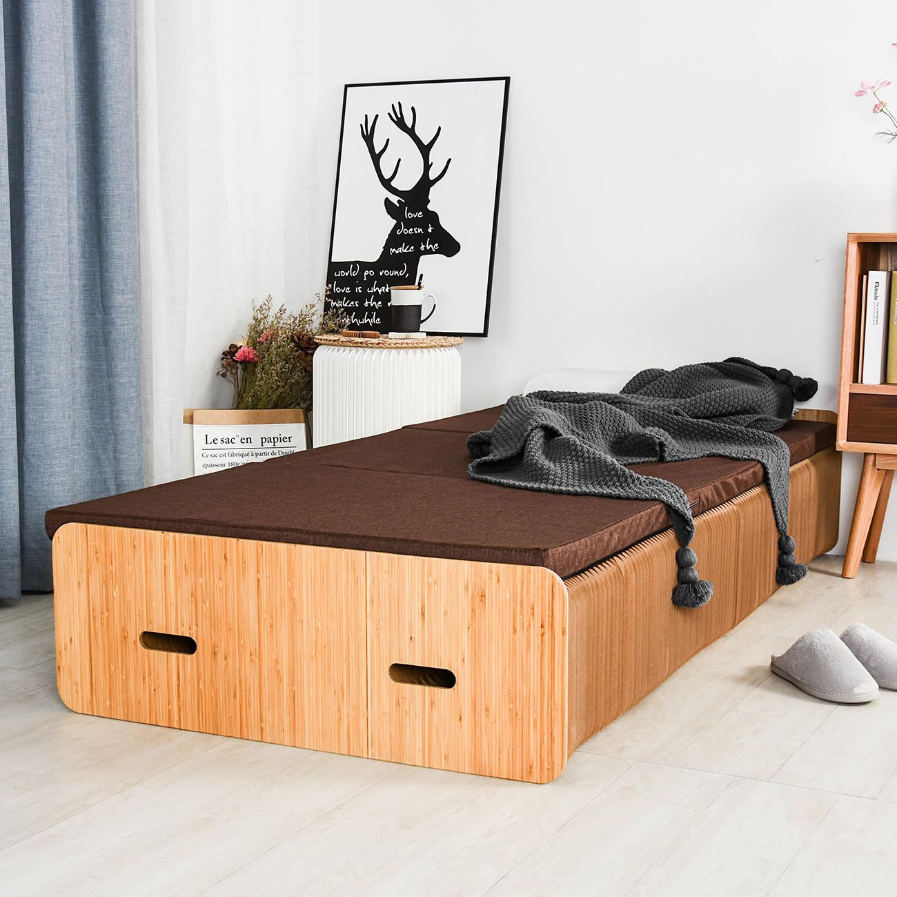 A pull-out bed made of accordioning paper
