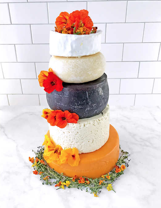You can get a 5-tier wedding cake made of cheese at Costco