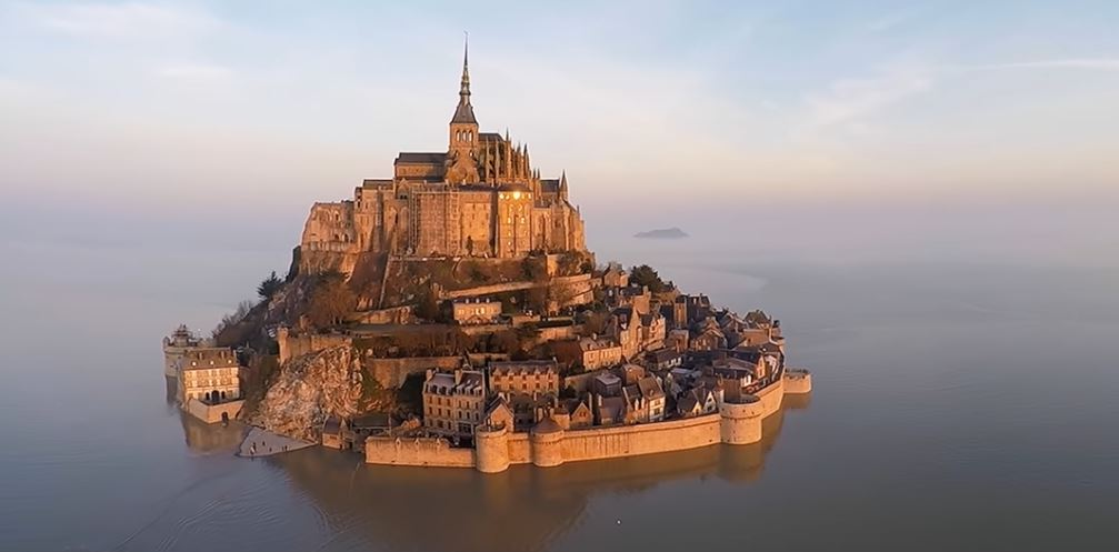 Mont Saint Michel and St. Michael's Mount: drone footage of two tidal islands