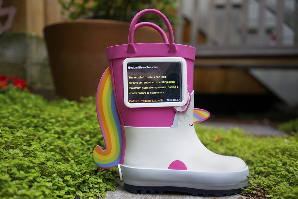 Turning a recalled children's unicorn boot into a display for endless product recall notices