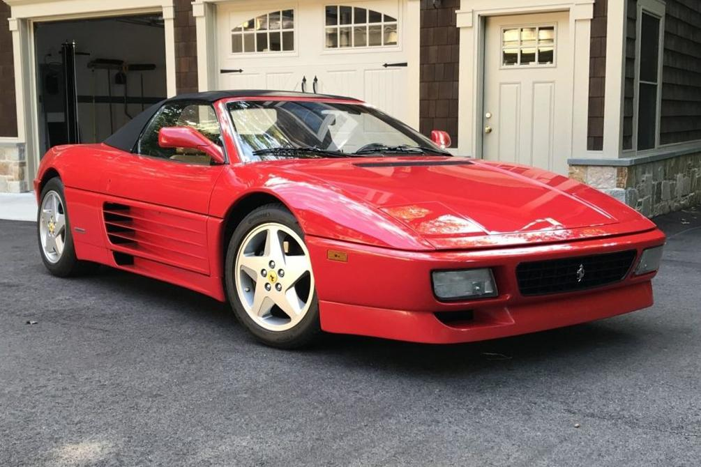 This 1995 Ferrari 348 Spider is enhanced by a Pioneer CD