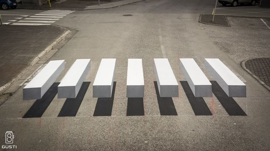 Photo of floating-bar illusion painted on a road