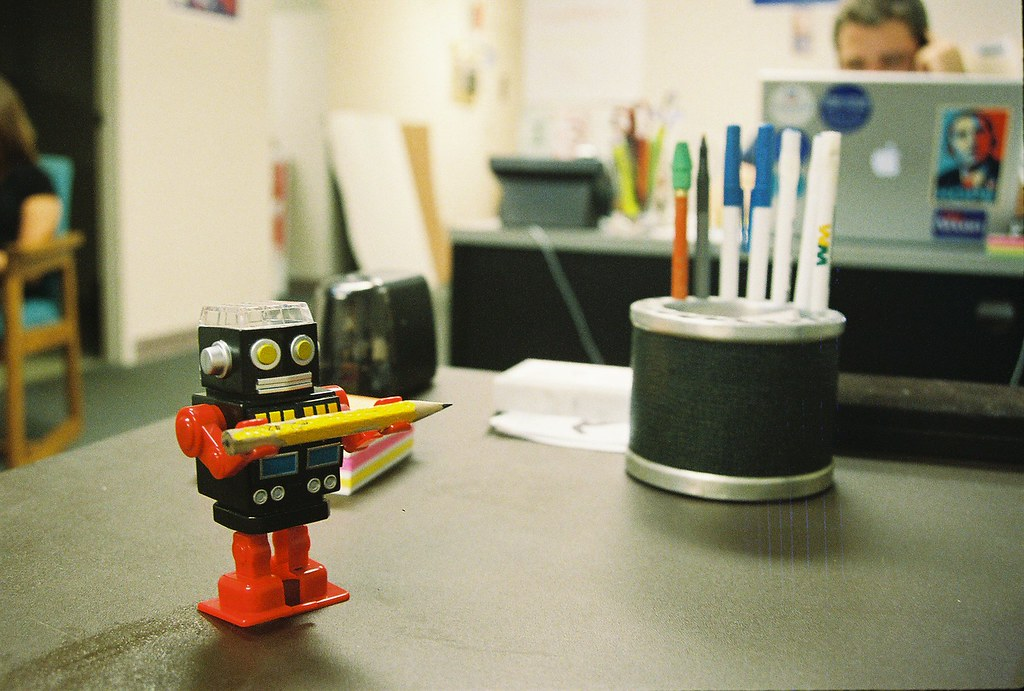 Photo of a toy robot carrying a pencil, by Matthew Hurst