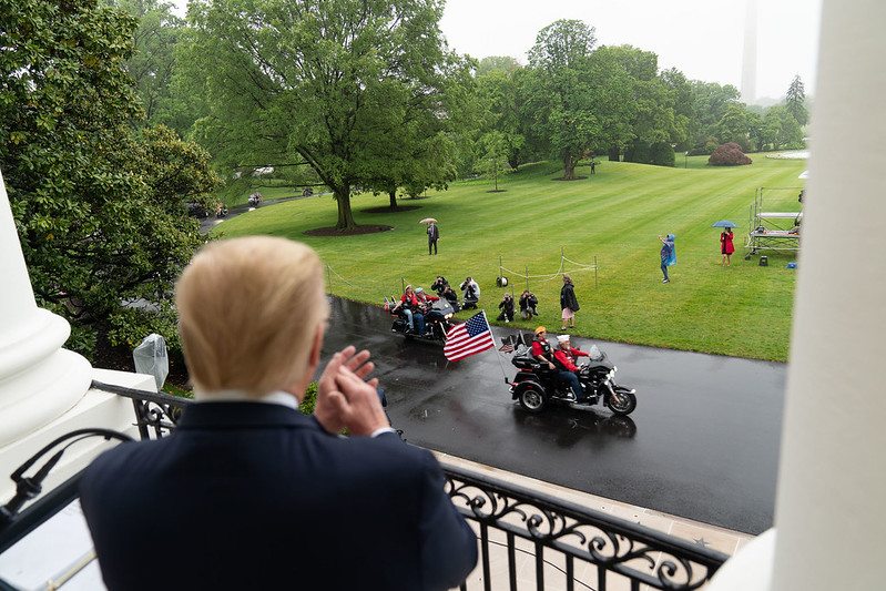Donald Trump claps his tiny hands as veterans ride their motorcycles along the South Drive of the White House Friday, May 22, 2020, during the Rolling to Remember: Honoring Our Nations Veterans and POW-MIA event. (Official White House Photo by Shealah Craighead)